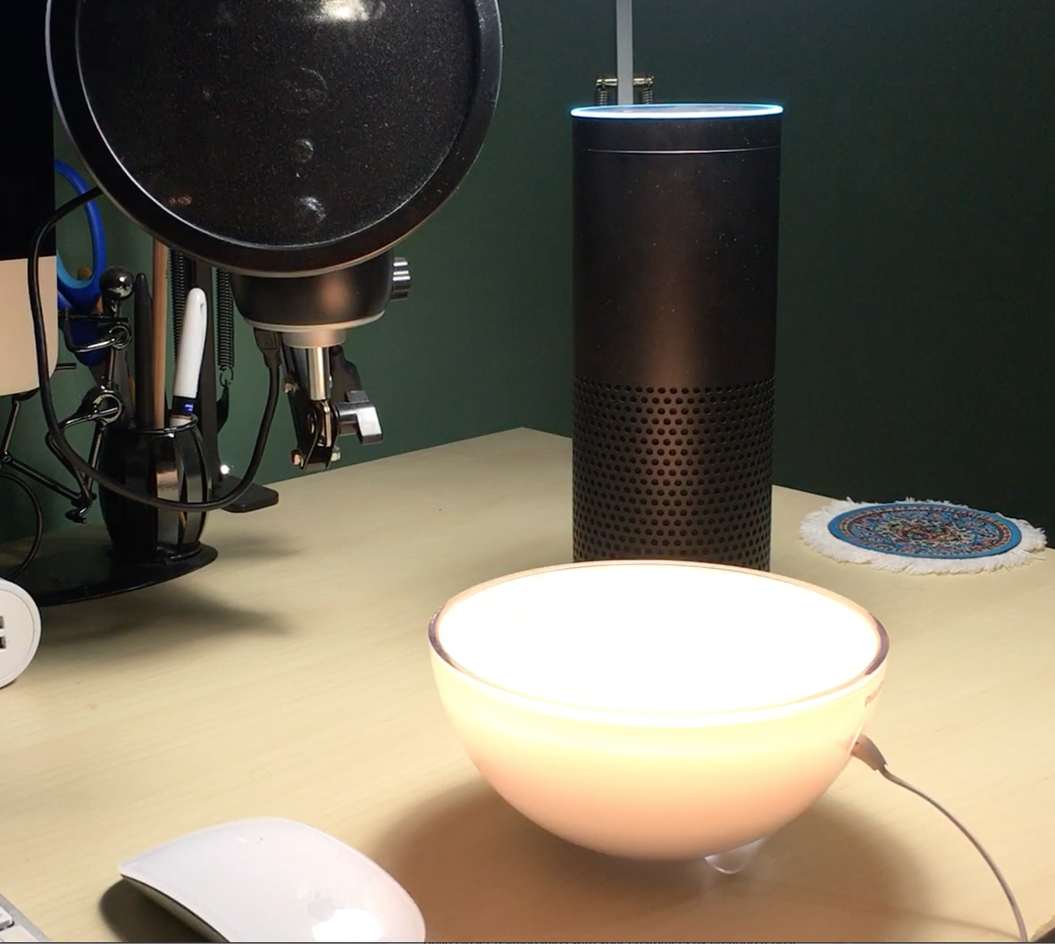 A smart bulb is seen blinking. Right behind it is Amazon Echo.